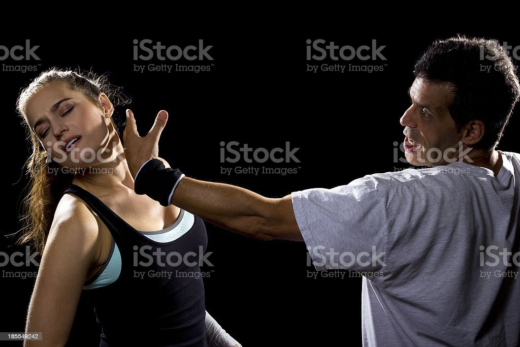 Young Fit Female MMA Fighter Fighting a Man royalty-free stock photo