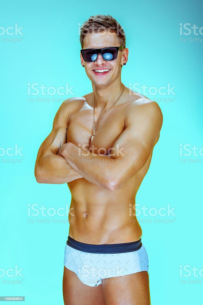 Young fit male in a swimwear royalty-free stock photo