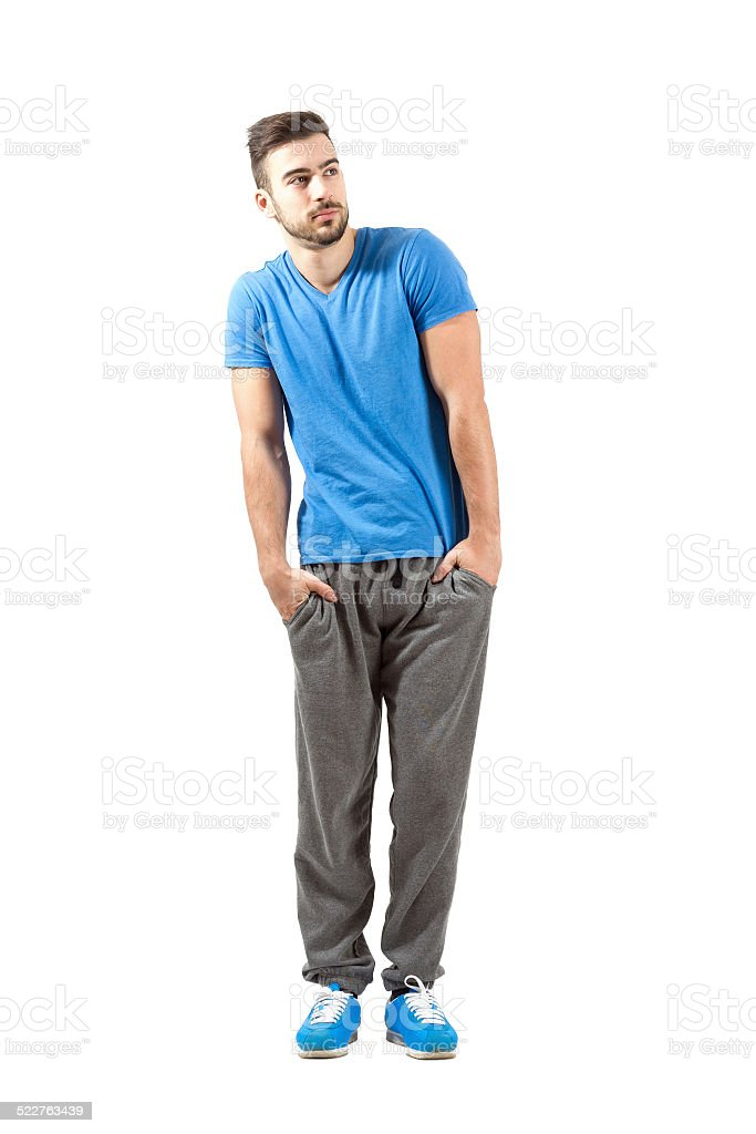 Young fit male in sportswear looking away stock photo