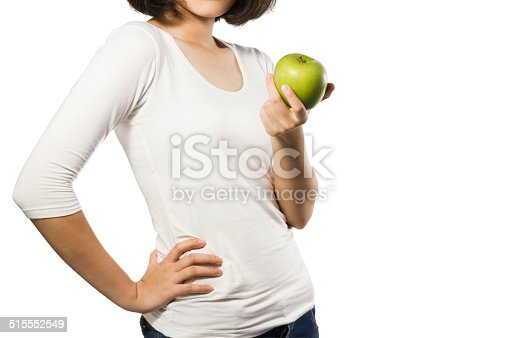 91837830 istock photo Young fit woman body with hand holding green apple. 515552549