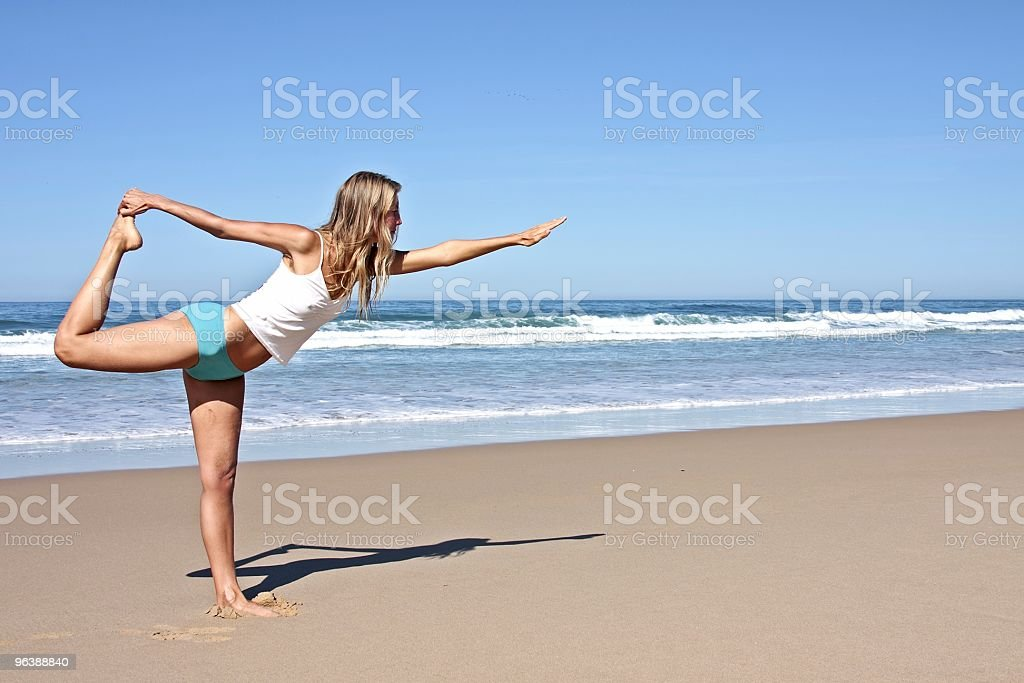 Young fit woman doing exercises on the beach - Royalty-free Adult Stock Photo