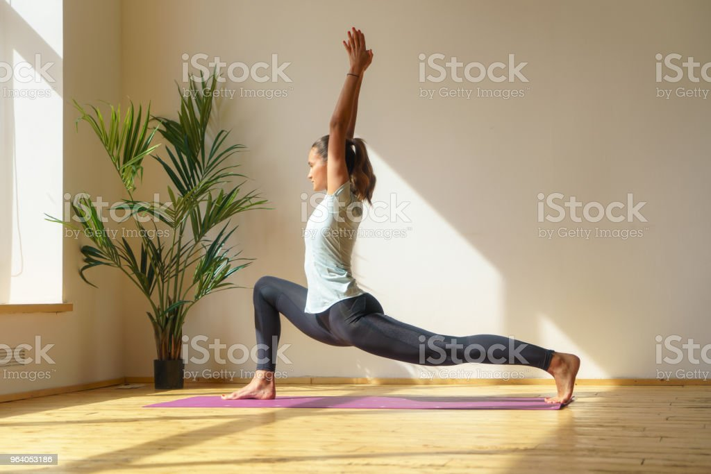 young fit woman doing stretching exercise - Royalty-free Adult Stock Photo