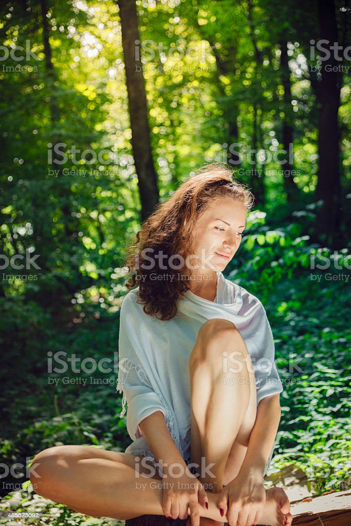 Young fit woman doing yoga in nature stock photo