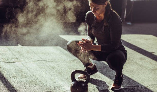 young fit woman exercise with kettleball - pesistica foto e immagini stock