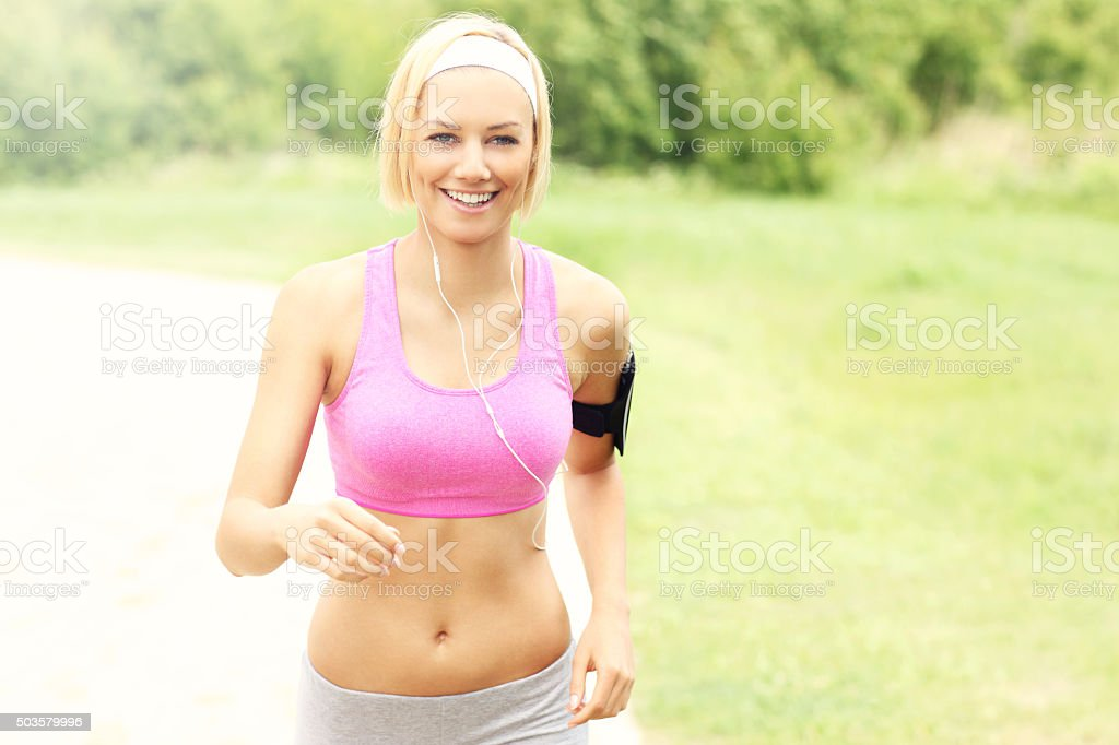 Young fit woman running stock photo