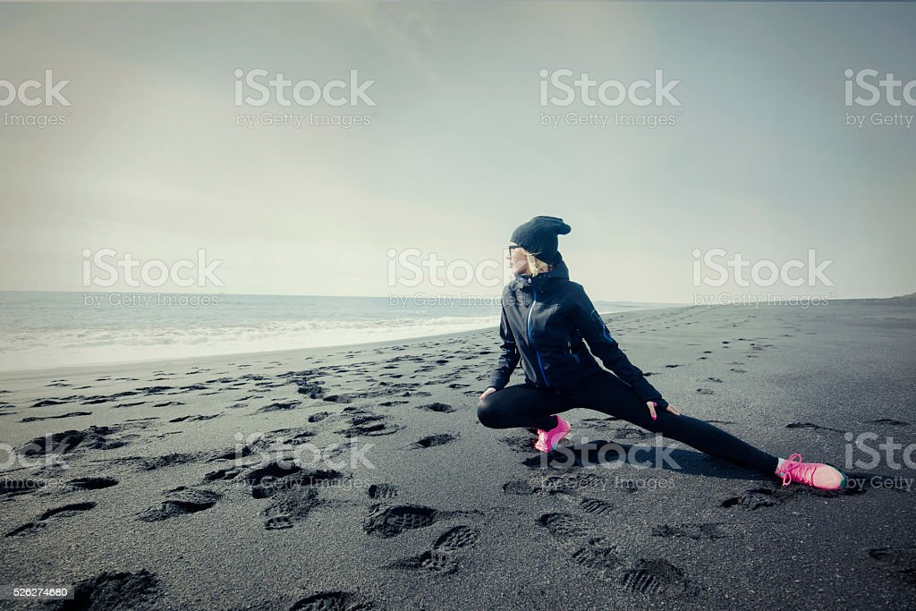 Young fit  woman stretches her leg after work out royalty-free stock photo