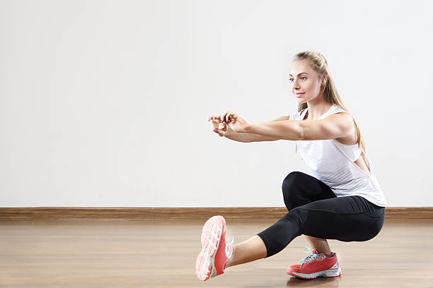 Young fit woman works out in the fitness class. stock photo