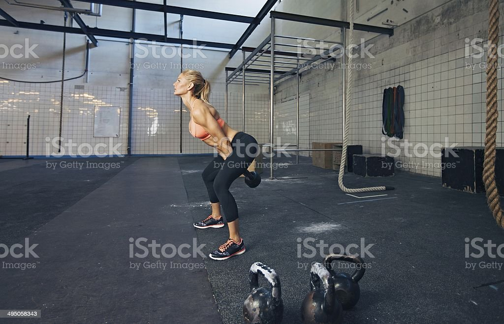 Young fitness female doing gym workout stock photo