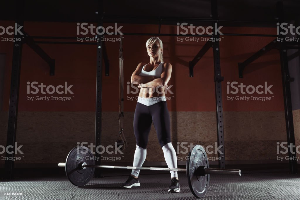 Young fitness girl is standing in the gym stock photo