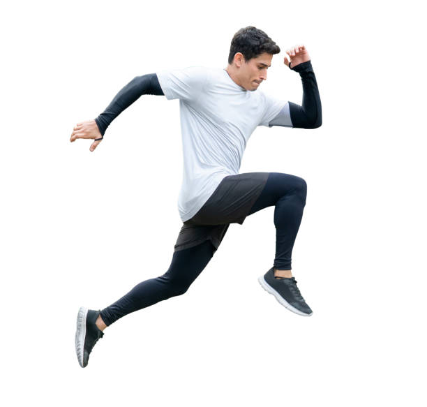 young fitness man in sportwear running isolated on white background with clipping path. exercise runner , jumping guy , workout ,sport ,training. side view stock photo
