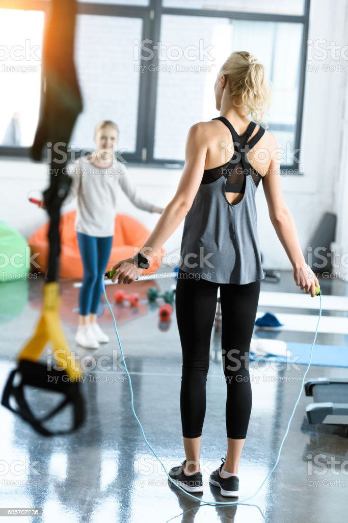 Young fitness people exercising with skipping ropes at sports center 免版稅 stock photo