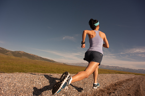 Young Fitness Sporty Woman Running On Rocky Seaside Stock Photo - Download Image Now