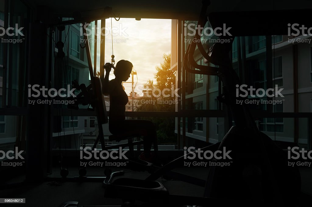young fitness woman execute exercise with exercise-machine Cable royalty-free stock photo