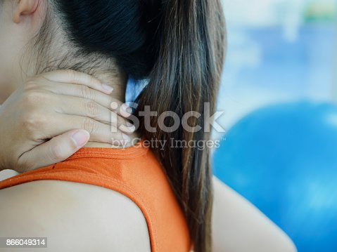 istock Young fitness woman  having neck pain after exercise with fitness ball background. 866049314