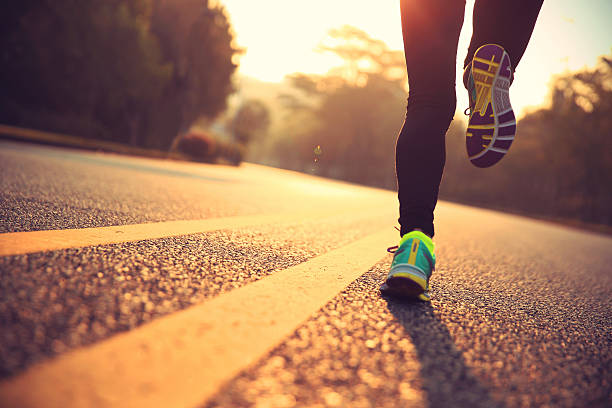 young fitness woman runner athlete running at road stock photo