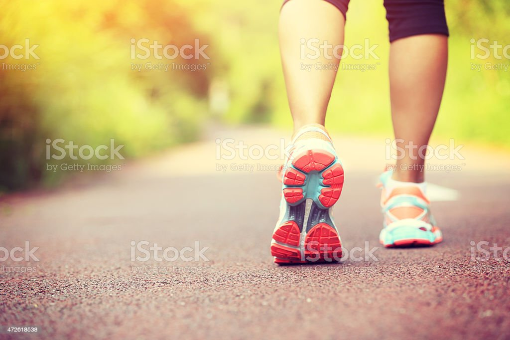 young fitness woman runner /hiker legs at forest trail stock photo