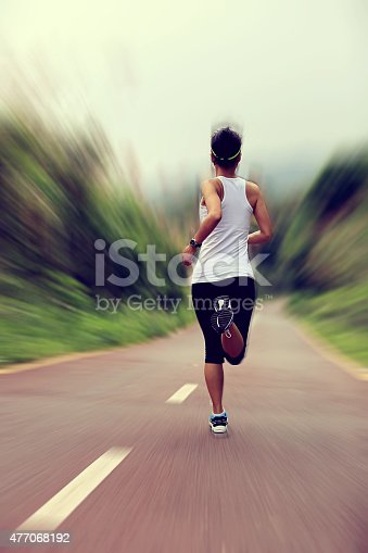 494003079istockphoto young fitness woman runner  running at forest trail 477068192