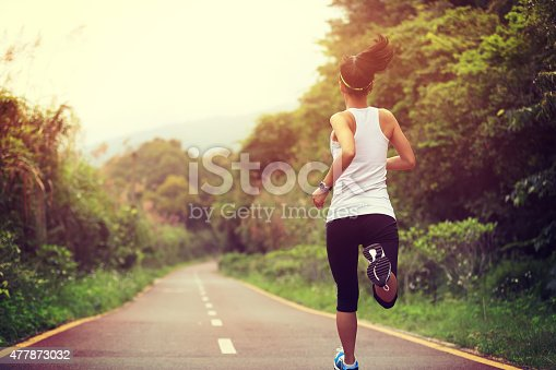 istock young fitness woman runner  running at forest trail 477873032
