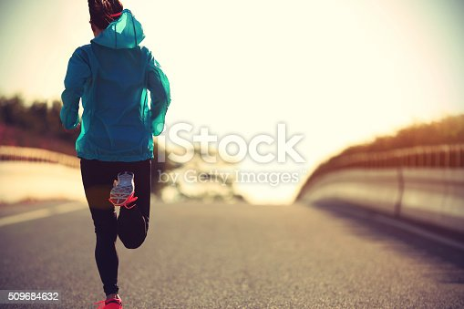 istock young fitness woman runner running on sunrise road 509684632