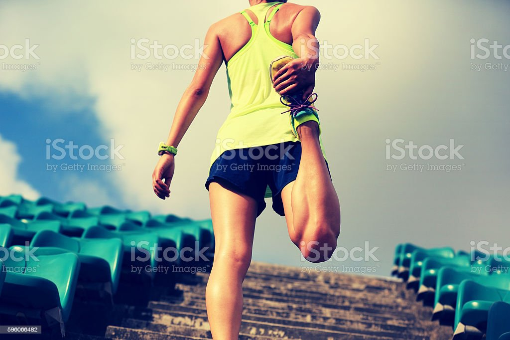 young fitness woman runner warm up on stairs royalty-free stock photo
