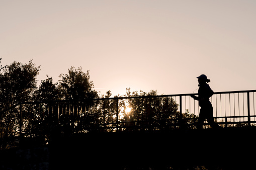 Young Fitness Woman Running On The Bridge Stock Photo - Download Image Now