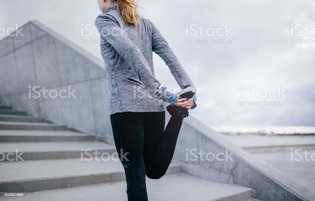 Young fitness woman stretching her leg stock photo