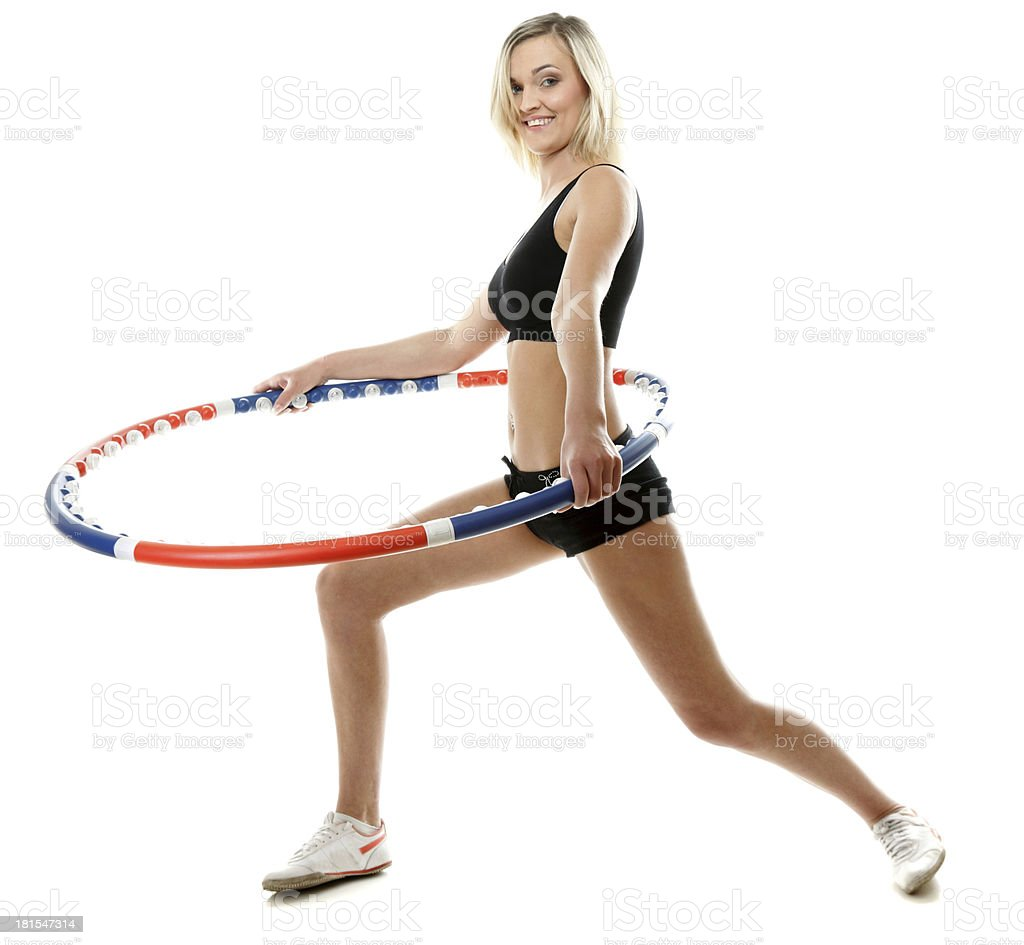 young fitness woman with hula hoop isolated royalty-free stock photo