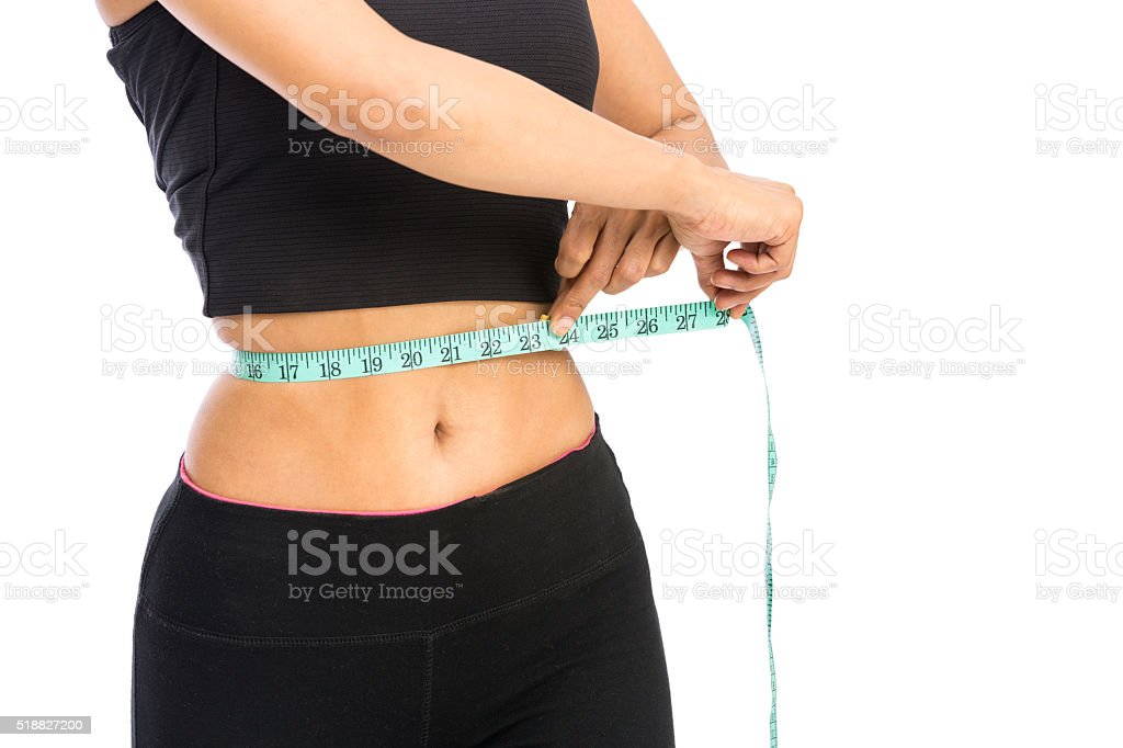 young fitness women measuring her waist stock photo