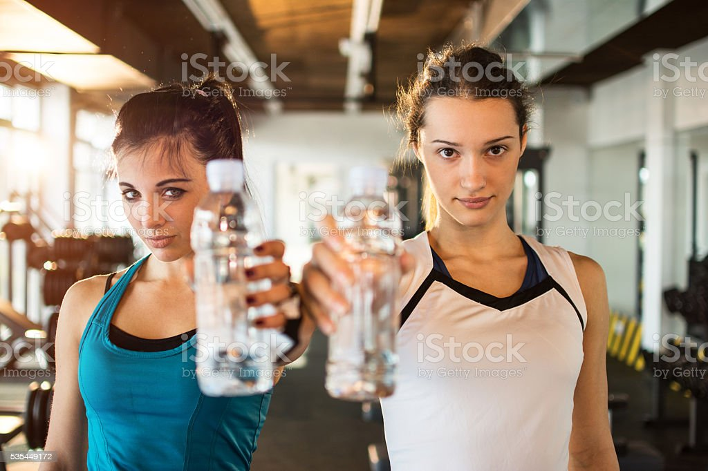 Young fitness women with water bottles. stock photo