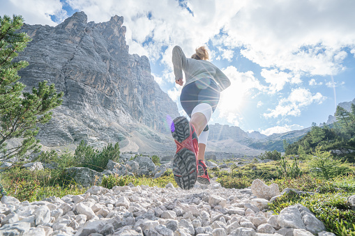 istock Young fitted woman trail running in the dolomites, Italy 870146302
