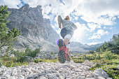 Sportive young woman exercising trail running on mountain trail in Alto Adige, Italy. People body conscious and heathy lifestyle concept.