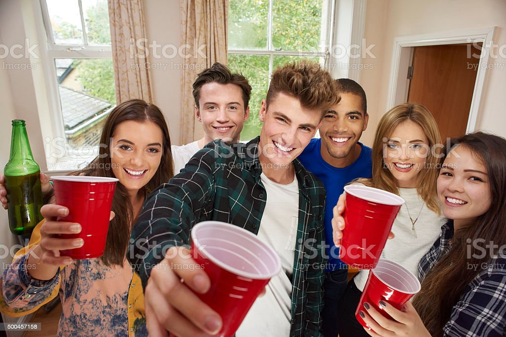 young flatmates drinks party stock photo