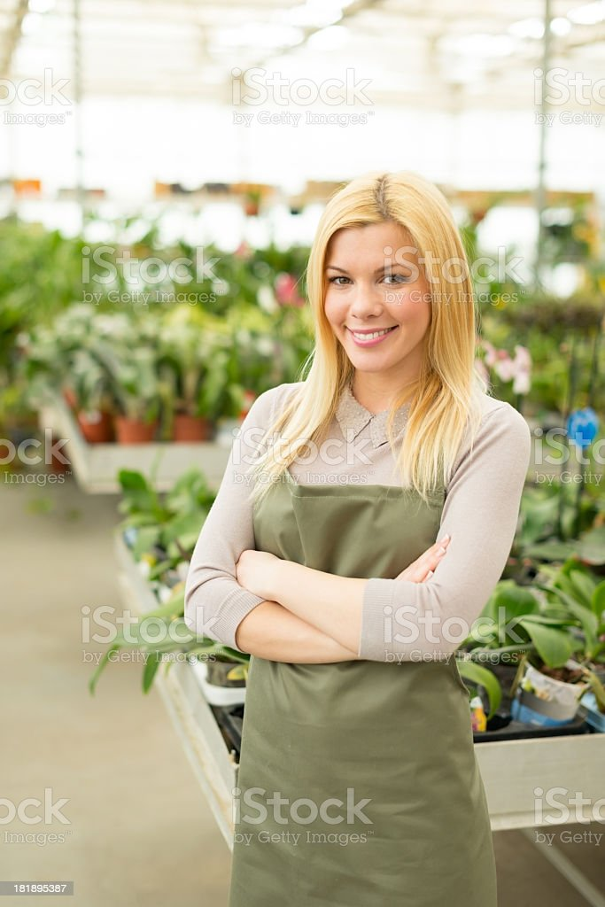 Young florist posing in greenhouse royalty-free stock photo