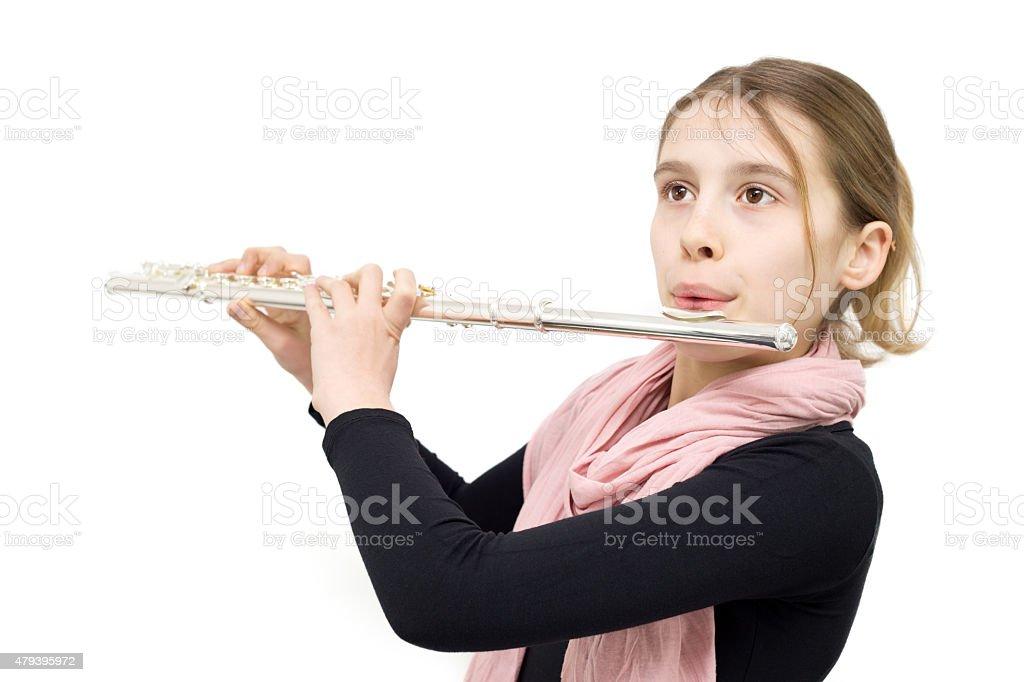 Young Flute Player Performing Indoors Against White Background stock photo