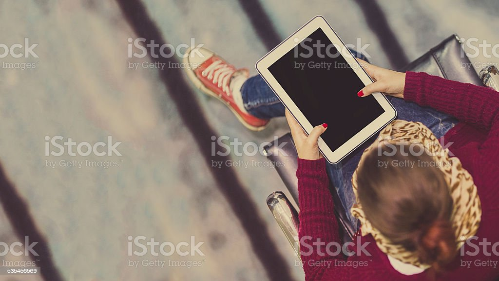 Young focused student using a tablet computer stock photo