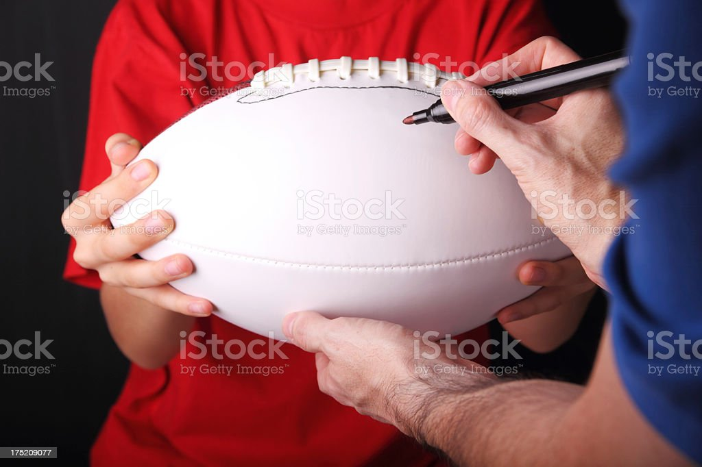Young Football Fan Getting An Autograph stock photo