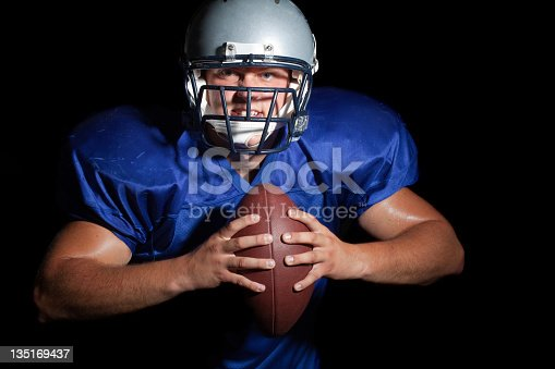 istock Young football player 135169437