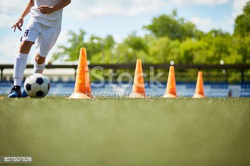 istock Young Footballer Enjoying Practice 827507526