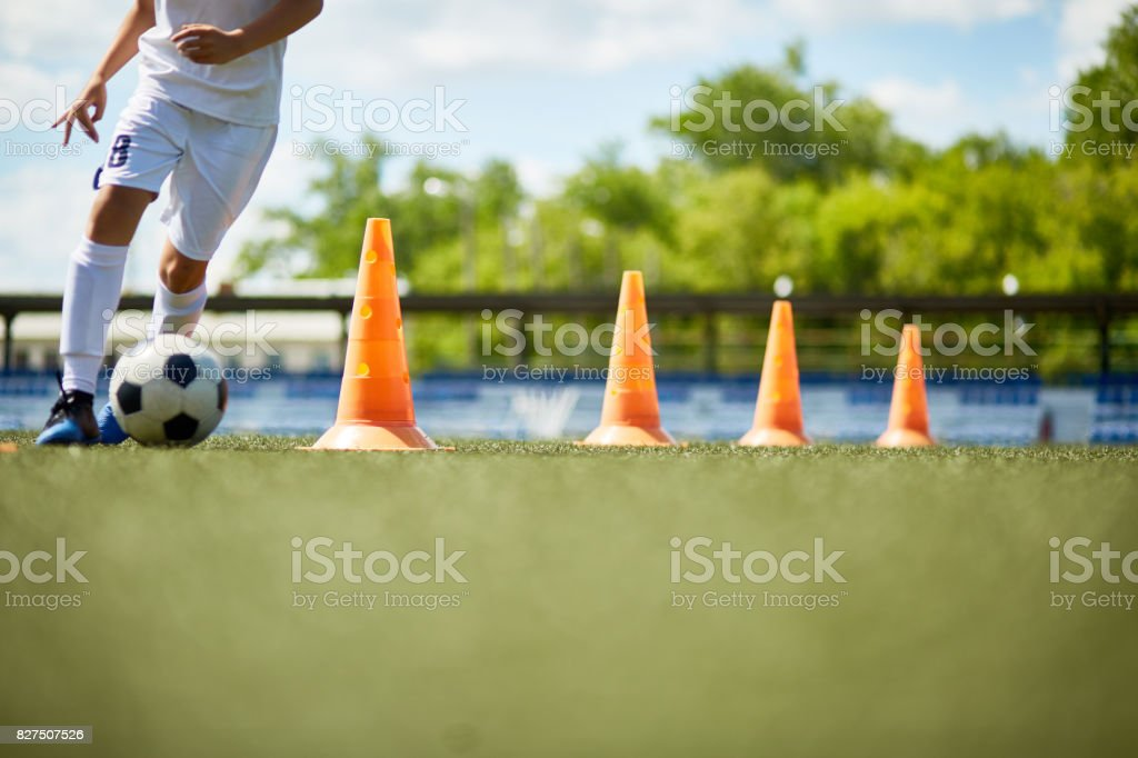 Young Footballer Enjoying Practice stock photo