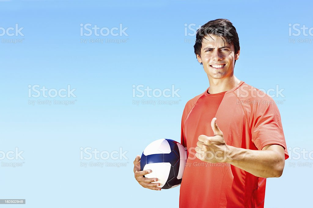 Young footballer gesturing a success sign royalty-free stock photo