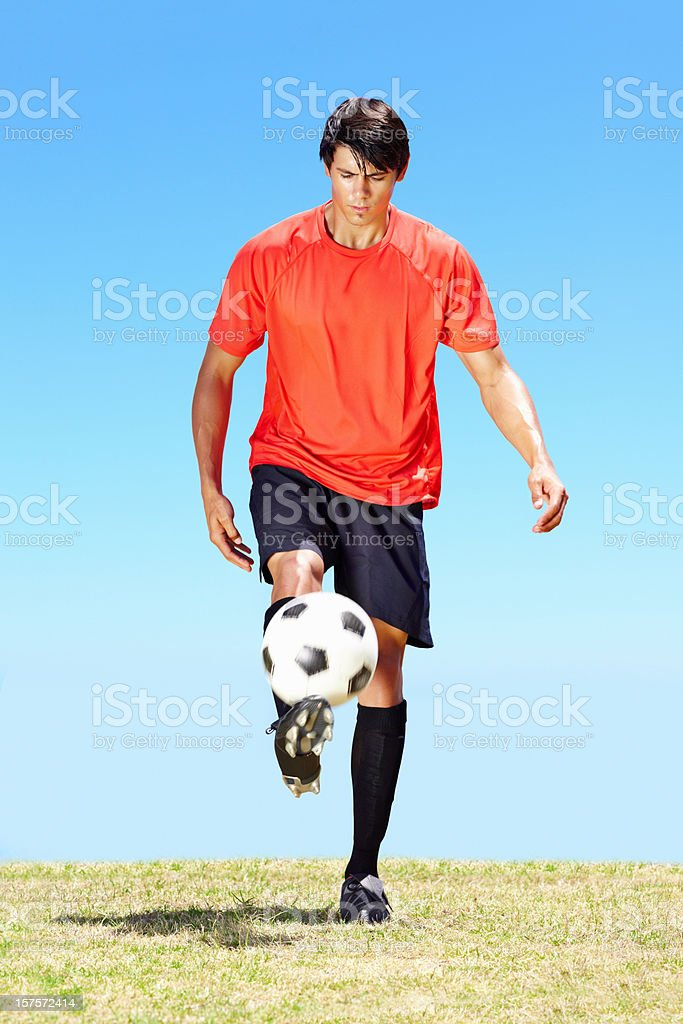 Young footballer with skills on the field royalty-free stock photo