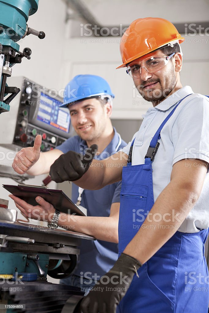 Young Foreman and Machine Operator royalty-free stock photo