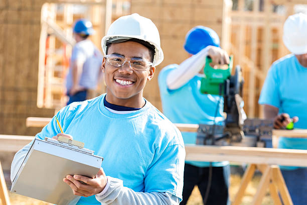 Young foreman at new home work site stock photo
