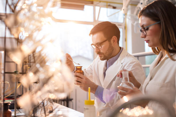 Young forensic scientists making a medical experiment in a laboratory, stock photo