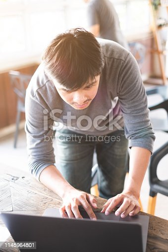 1170085960 istock photo Young freelance programer man working with computer laptop - Program development concept. 1145964801