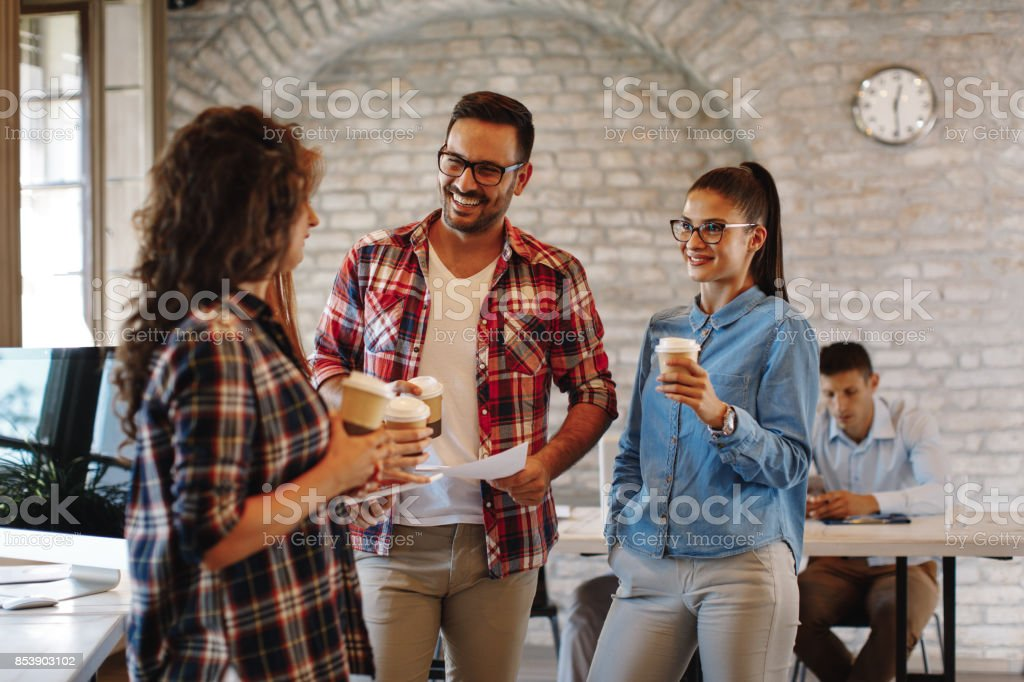 Young freelance team at a coffee break royalty-free stock photo
