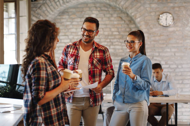 Young freelance team at a coffee break stock photo