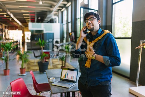 1040964880 istock photo Young freelancer in his cool office 1163334119