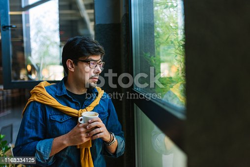 1040964880 istock photo Young freelancer in his cool office 1163334125