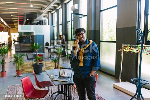 1040964880 istock photo Young freelancer in his cool office 1163334169